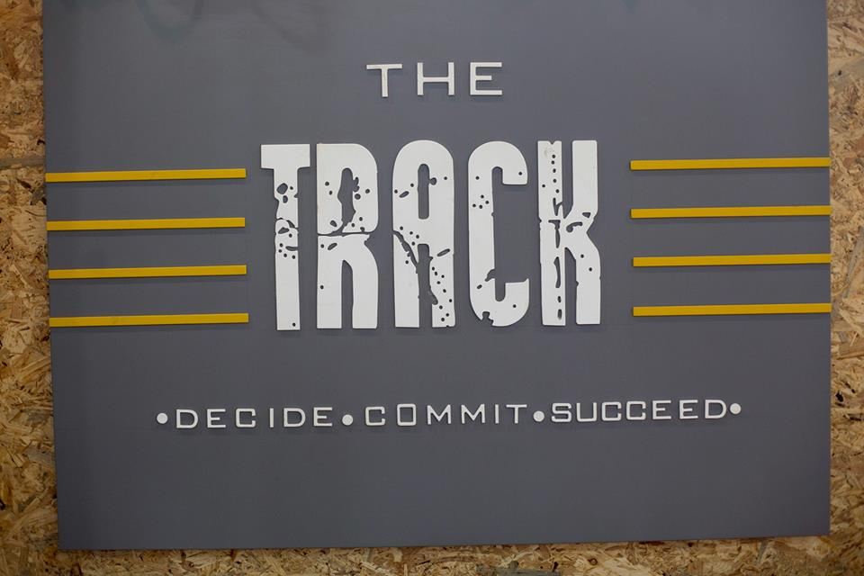 Logo of The Track Gym Powered By Trained Women